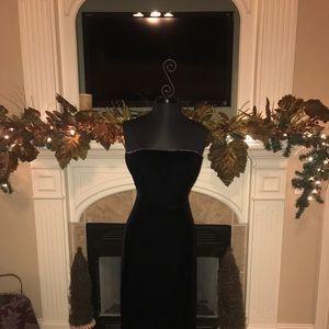 Black velvet formal dress with rhinestone detail.